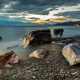 Stones by Pece Nastevski - Landscapes Caves & Formations ( water, sunset, ohrid, lake, beach, bridge, stones, macedonia, city )
