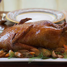 Slow-Roasted Duck with Olive Gravy and Garlic-Fennel Confit
