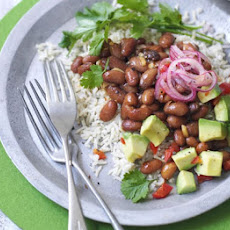 Warm Mexican rice salad with borlotti beans & avocado salsa