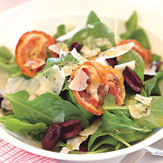Arugula Salad with Olives, Pancetta, and Parmesan Shavings