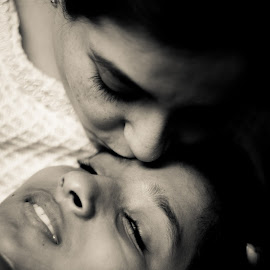 Grown up love by Savneet Kaur - People Family ( kiss, mother and daughter, black and white, forehead, teenage daughter )