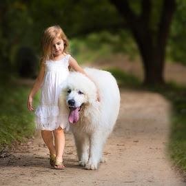 Walk my pet by Ashwin Chathuruthy - Babies & Children Children Candids ( little girl, blurred background, white dog, white dress, big dog, walking on a path )