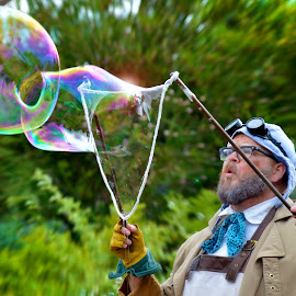 Master Bubble Blower by Les Walker - People Musicians & Entertainers ( bubbles, rainbow, blow, entertainer, man,  )