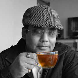 The man with his morning tea by Simantini Hazra - People Portraits of Men ( red, black & white, tea, man, father )