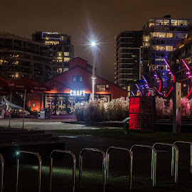 Athlete's Village by Cory Bohnenkamp - City,  Street & Park  Night ( olympic, games, night, 2010, square, athletes village, city )