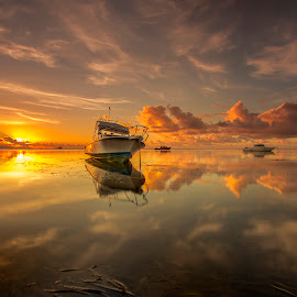 Tranquil at Sunrise by Choky Ochtavian Watulingas - Landscapes Sunsets & Sunrises ( clouds, sky, boats, golden_hour, reflections, seascape, sunrise )