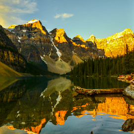 Moraine Lake by Joseph Law - Landscapes Waterscapes ( in the morning, blue sky, trees, reflections, shine upon, rocks, moraine lake, lodge, the rocky mountains )