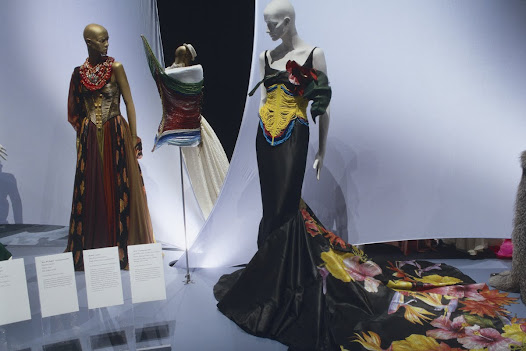 "Most designers tend to focus on very feminine or beautiful corsets, but there are also a variety of ""exotic"" corsets. The Dinka ""corset"" from East Africa (center) was the inspiration for this Dior gown."