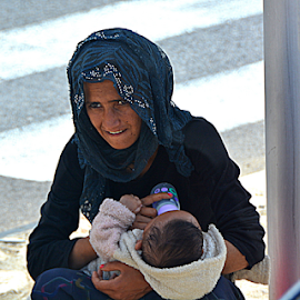 Poverty2 by Rita Uriel - People Street & Candids ( poverty, woman, feeding, eating, baby, middle east )