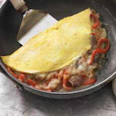 Philly Cheesesteak Omelette with Onions and Bell Peppers