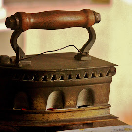 In solid service for many decades.. by Anoop Namboothiri - Artistic Objects Antiques ( ironing, tools, sun reflection, industrial, wooden handle, coal, anoop namboothiri, old technology, brass, antique, iron, okd,  )