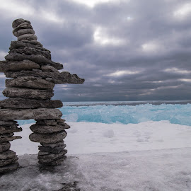 inukshuk on the edge by Roland Bast - Landscapes Weather ( nature, canada, blue, inukshuk, ice, ontario, skies )