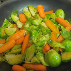Baby Carrots And Brussels Sprouts Glazed With Brown Sugar and Pepper