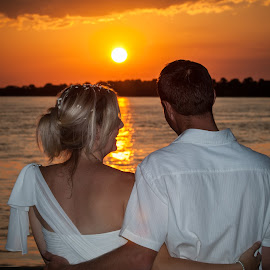 Bride & Groom at sunset by Werner Booysen - Wedding Bride & Groom ( wedding photos destination, wedding photography, sunset, wedding day, wedding, zambia, bride, groom, werner booysen, river )