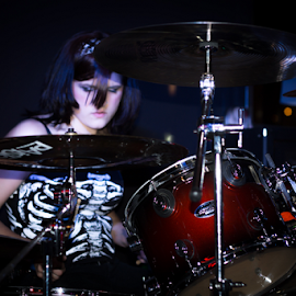 Metal Mandy by George Brandon - People Musicians & Entertainers ( concert, female, musician, low light, drums, Lighting, moods, mood lighting )