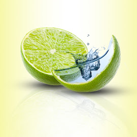 Lime Splash by Paul Thomson - Digital Art Things ( water, fruit, splash, ice, green, lime )