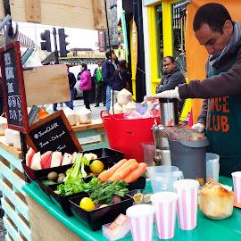 Juice bar in Camden Market. by Michelle Harris - City,  Street & Park  Markets & Shops ( fruit, market, camden market, london, color, vegetables, juicing )