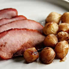 Mustard and Brown Sugar-Rubbed Ham With Balsamic-Roasted Onions