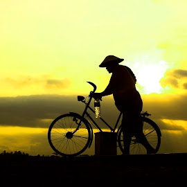 by Ismanto Lungsi - Transportation Bicycles ( sunset, man, bicycle )