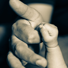 Holding on tight by Savneet Kaur - People Body Parts ( black and white, hands, baby, newborn, father )