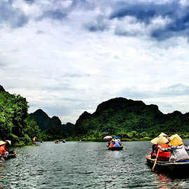 Towards the land by Susi Solichin - Transportation Boats ( midday, rowing boat, racing, vietnam, boat )
