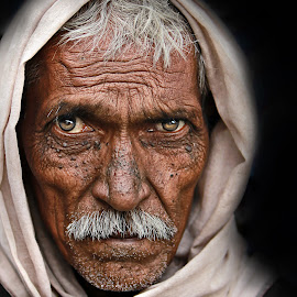 The Glance by Pronab Kundu - People Portraits of Men ( street photography )