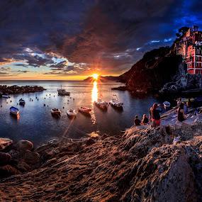 Sunset in Riomaggiore by Zoltan Duray - Landscapes Sunsets & Sunrises ( water, cinque terre, europe, colors, riomaggiore, sea, house, travel, seascape, boat, people, coast, mountains, seagull, village, sunset, liguria, mediterranean, italy, rocks, la spezia,  )