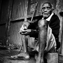 Old Man in Black by Eko Premono - People Portraits of Men