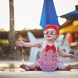 Girls Just Wanna Have Fun by Christine O'Connell - Babies & Children Children Candids ( water, splash, vintage, baby girl, bathing cap, retro, summer fun, stripes, sunglasses, red and white, happy baby, red, stylish, old fashioned, baby, bow )