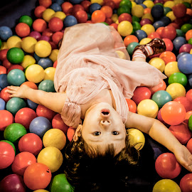 Feel so comfort...... by Irwan Budiarto - Babies & Children Child Portraits ( balls, girl, relax, kids,  )