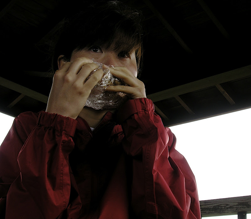Aya eating a sandwich on Ashiwadayama