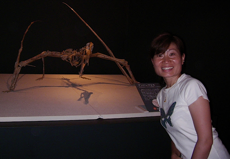 Aya with a walking skeleton of a pterosaur