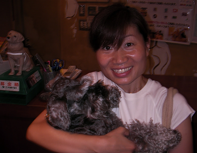 Aya with a calm Schnauzer