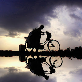 by Ismanto Lungsi - Transportation Bicycles ( water, bike, man )