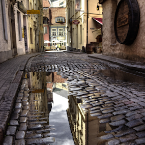 Old street by Julija Moroza Broberg - City,  Street & Park  Historic Districts ( old house, reflection, old, colorful, brick, street, street art, old city, old town, architecture, cityscape, city, empty, buildings, rain, houses, urban landscape, old building, reflecting, street photography, mirrored reflections, urban, old street, narrow, architectural, puddle, town, stones )