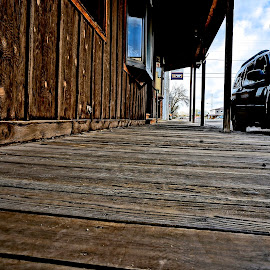 Real Rustic in Wyoming by Barbara Brock - City,  Street & Park  Street Scenes ( wood sidewalk, western sidewalk, wyoming small town street )