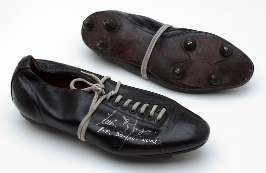 """These football boots, leather with their little metal studs, speak of another era..."" David Goldblatt, Football Writer"