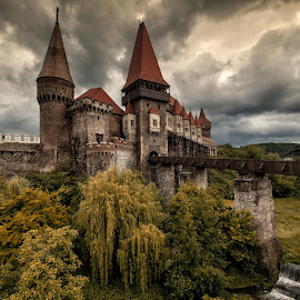 Corvin Castle by Grigore Roibu - Buildings & Architecture Public & Historical ( building, waterfall, romania, travel, museum, storm, history, arhitecture, outdoor, outdoors, fortification, castle, monument, ruins, bridge, medieval, transylvania )