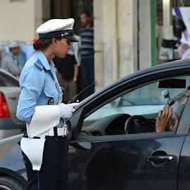 I am so sorry, madam. by Marcel Cintalan - City,  Street & Park  Street Scenes ( street scene, police woman, morocco )