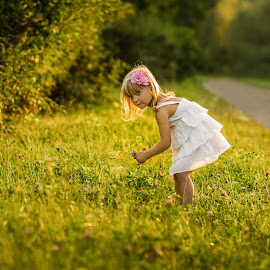 Gathering flowers by Vitaly Petrishin - Babies & Children Child Portraits ( child, sony, ivano-frankivsk, flowers )