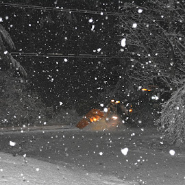 Through the Snow by Susan Jewell - Transportation Roads ( night shots, plowing, sanding, truck, snowing )