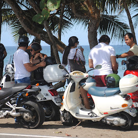 Together At The Beach by Noemi Cappiello-Acosta - People Couples ( puerto rico, bikes, trees, beach, drinks, people )
