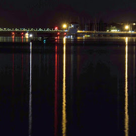 Bridge Night Lights by Rich Eginton - Transportation Other ( water, color, florida, indian river lagoon, reflections, lines, night, bridge, vertical lines, pwc )