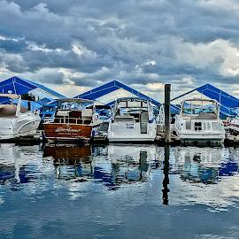 Dock Heaven by Barbara Brock - City,  Street & Park  Vistas ( water reflections, cloudy skies, marina, boats docked )