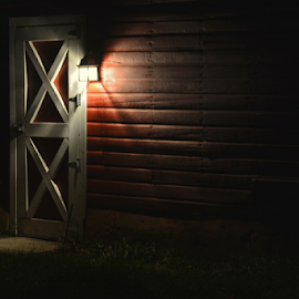 A light in the darkness by Jill Beim - Buildings & Architecture Other Exteriors ( buildings, mood lighting, darkness, light, old barns, Lighting, moods )
