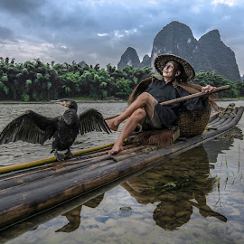 Relax by Fuad Rahim Asman - People Portraits of Men ( bird, sit, landscape, guilin, river )