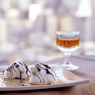 Snow Eggs with Pistachio Custard and Chocolate Drizzle