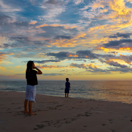 Mother & Son at sunset by Loredana  Smith - People Street & Candids ( relaxation romance, ocean, travel, beach, beauty, coastline, landscape, sun, coast, escape, solitude  tourism, tranquil, sky, nature, ripples, idyllic, climate, clouds, water, sand, waves, sea, vacations, paradise, coastal, tourist, traveling, serene, sunset, australia, view, panoramic )