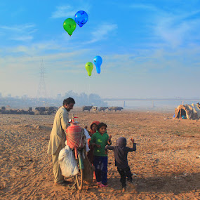 Children playing with baloons by Sheraz Mushtaq - People Street & Candids ( gas, cycle, cylinder, children, kids, balloon, nomad, seller )