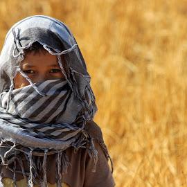 a child from barren park by Muchtamir Muchtamir - People Portraits of Men